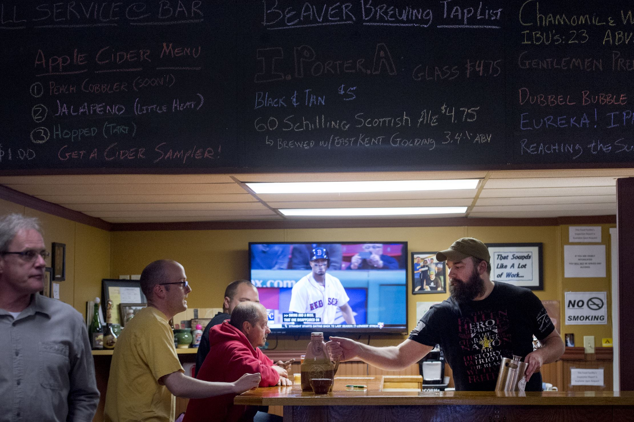 20170504scBeaverBrewing07-6 Cider master Josh DeMaria manages the bar on Thursday, May 4, 2017 at Beaver Brewing in Beaver Falls.