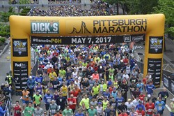 Runners move past the starting  line of the 2017 Pittsburgh Marathon, May 7, 2017.