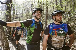Justin Severino, left, and Jason Church at Pisgah National Forest during a culinary mountain biking tour near Asheville, N.C.