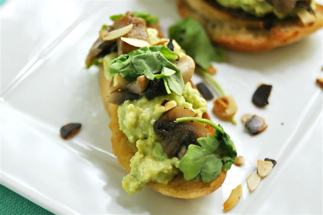 Smashed avocado and fried mushrooms on toast come together in a snap.