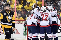 Capitals teammates celebrate a goal by T.J. Oshie in the first period of Game 6 of the Eastern Conference semifinals Monday at PPG Paints Arena.