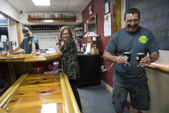 Co-owners Steve Petrucci, Kathy Petrucci and Dave Petrucci smiles as they serve their guests on Friday, May 5, 2017 at Petrucci Brothers Brewing in New Brighton.