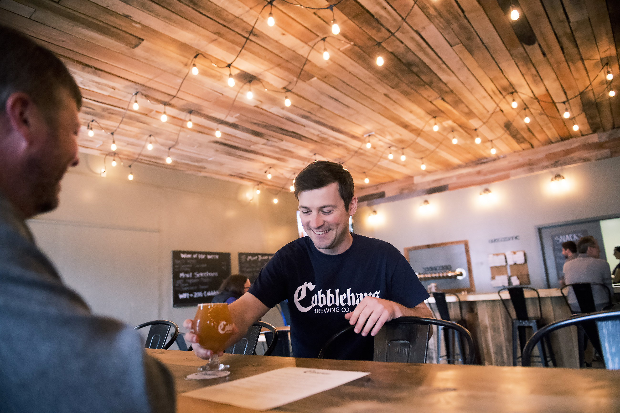 20170505scCobblehaus-03-5 Chris Kozlowski serves a customer on Saturday, May 6, 2017 at Cobblehaus Brewing Company in Coraopolis. part of an Ohio River beer trail from Pittsburgh to Beaver County. (Steph Chambers/Post-Gazette)