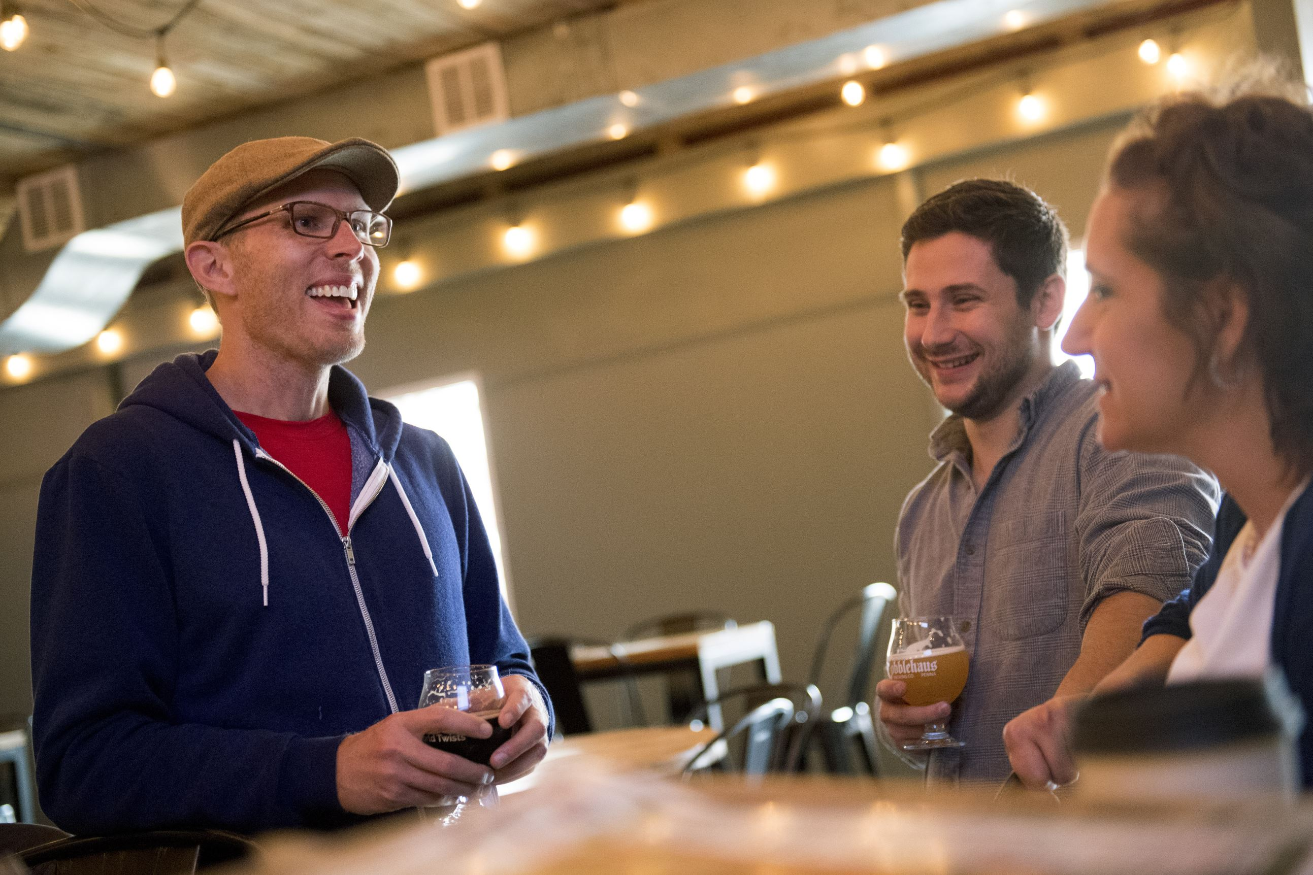 20170505scCobblehaus-02-4 Dane Vandenberg, Ryan Singer and Janet Mills enjoy beer on Saturday, May 6, 2017 at Cobblehaus Brewing Company in Coraopolis. (Steph Chambers/Post-Gazette)