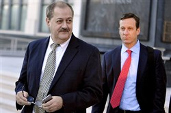 In a Nov. 24, 2015, photo, former Massey Energy CEO Don Blankenship, left, walks out of the Robert C. Byrd U.S. Courthouse after the jury deliberated for a fifth full day in his trial, in Charleston, W. Va. Blankenship is finishing up his one-year federal prison sentence related to the deadliest U.S. mine explosion in four decades. According to the U.S. Bureau of Prisons website, Blankenship is set to be released Wednesday, May 10, 2017, from a halfway house in Phoenix. He must serve one year of supervised release.