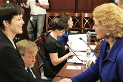 U.S. Sen. Debbie Stabenow, D-Mich, right, greets Pennsylvania Insurance Commissioner Teresa Miller Wednesday. Ms. Miller was in Washington to tell the Democratic Policy and Communications Committee how the Affordable Care Act worked in Pennsylvania.