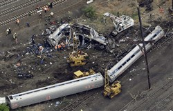 In this May 13, 2015, file photo, emergency personnel work near the wreckage of a New York City-bound Amtrak passenger train following a derailment that killed eight people and injured about 200 others in Philadelphia.