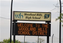 Signage for Woodland Hills Jr./Sr. High School along Greensburg Pike  in Churchill.