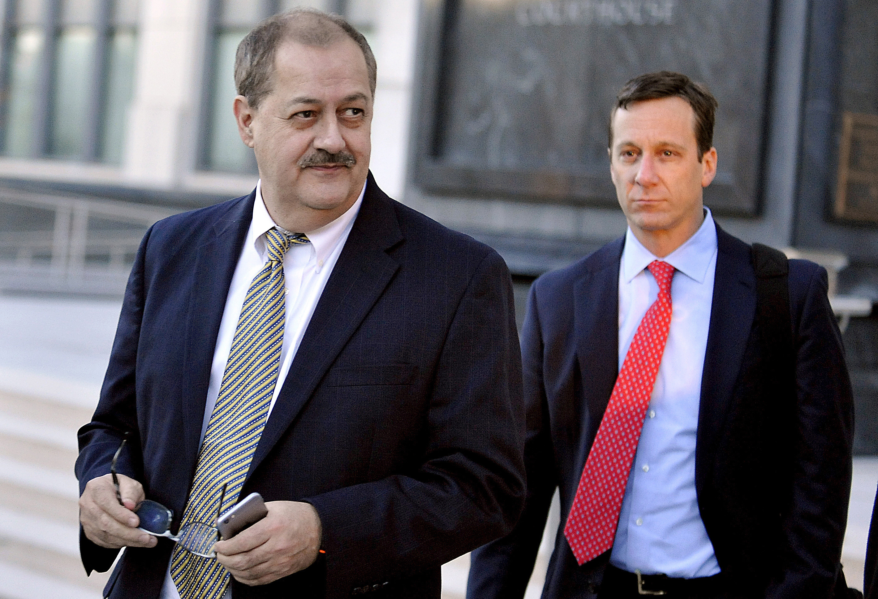 Mine Explosion-Prison Release In a Nov. 24, 2015, photo, former Massey Energy CEO Don Blankenship, left, walks out of the Robert C. Byrd U.S. Courthouse after the jury deliberated for a fifth full day in his trial, in Charleston, W. Va. Blankenship is finishing up his one-year federal prison sentence related to the deadliest U.S. mine explosion in four decades. According to the U.S. Bureau of Prisons website, Blankenship is set to be released Wednesday, May 10, 2017, from a halfway house in Phoenix. He must serve one year of supervised release.