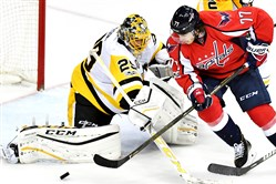 Penguins goaltender Marc-Andre Fleury makes a save on Capitals winger T.J. Oshie in the second period of Game 7 of the Eastern Conference semifinals May 10 at Verizon Center in Washington, D.C.