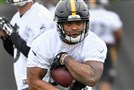 Running back Rushel Shell carries during Steelers rookie minicamp May 12. Shell, a Hopewell graduate, is hoping to make the team as an undrafted free agent.