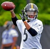 Steelers quarterback Joshua Dobbs drops back to throw during rookie minicamp May 12.