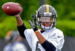 Steelers quarterback Joshua Dobbs drops back to throw in rookie minicamp Friday on the South Side.