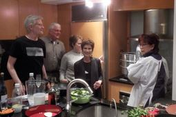 SENIOR-VILLAGES Culinary consultant Janet Cam (far right) explains how to steam a Chinese roasted duck to NextGen2.0 members Dan Abele, Dan Leathers, Patty Zweibel and Mary McIntosh in Washington, D.C.
