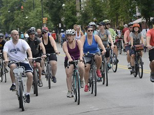 Lat July, bicycle riders roll down Western Ave on the North Side during Open Streets Pittsburgh.