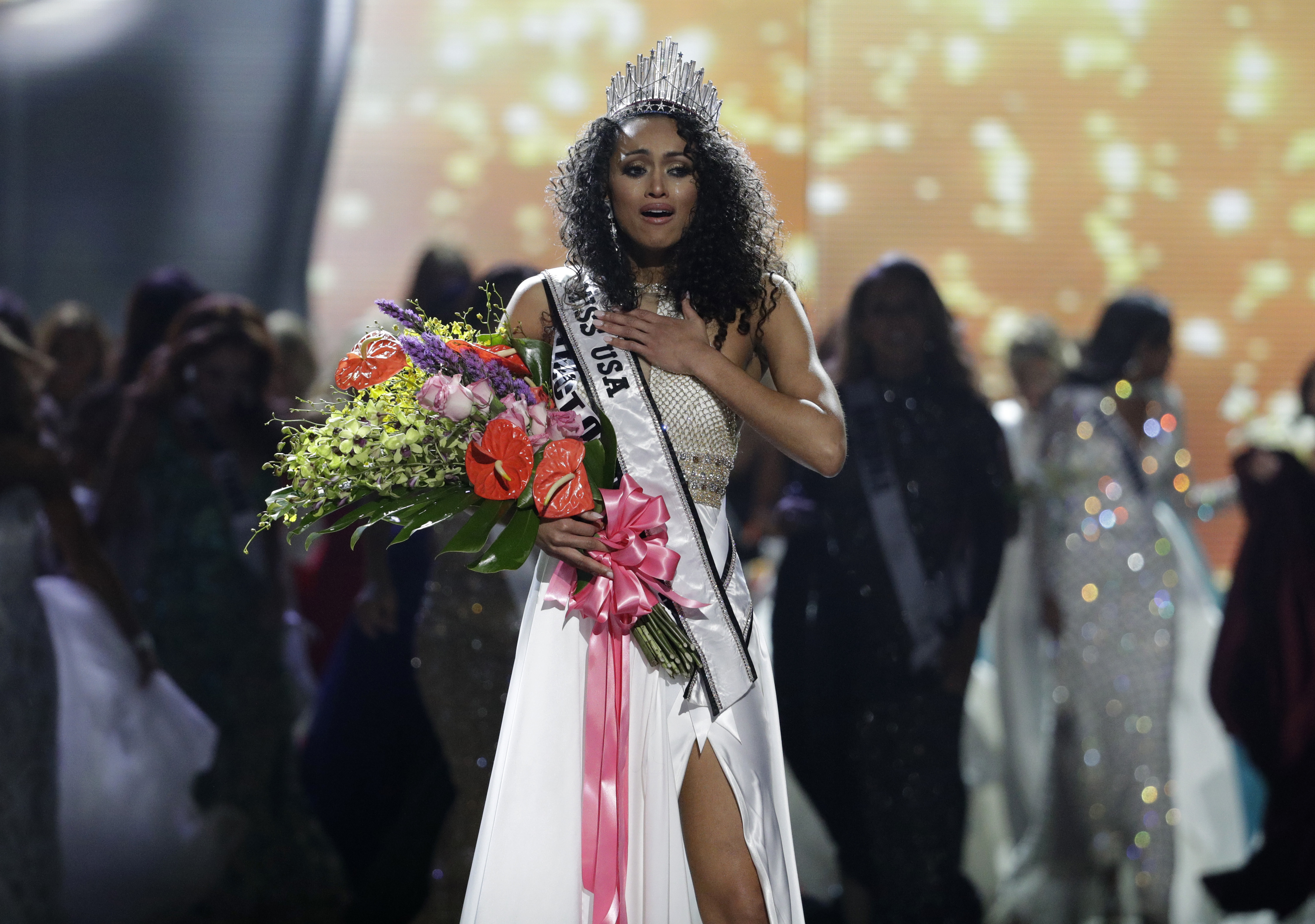 APTOPIX Miss USA Miss District of Columbia USA Kara McCullough reacts after she was crowned the new Miss USA during the Miss USA contest Sunday, May 14, 2017, in Las Vegas. (AP Photo/John Locher)
