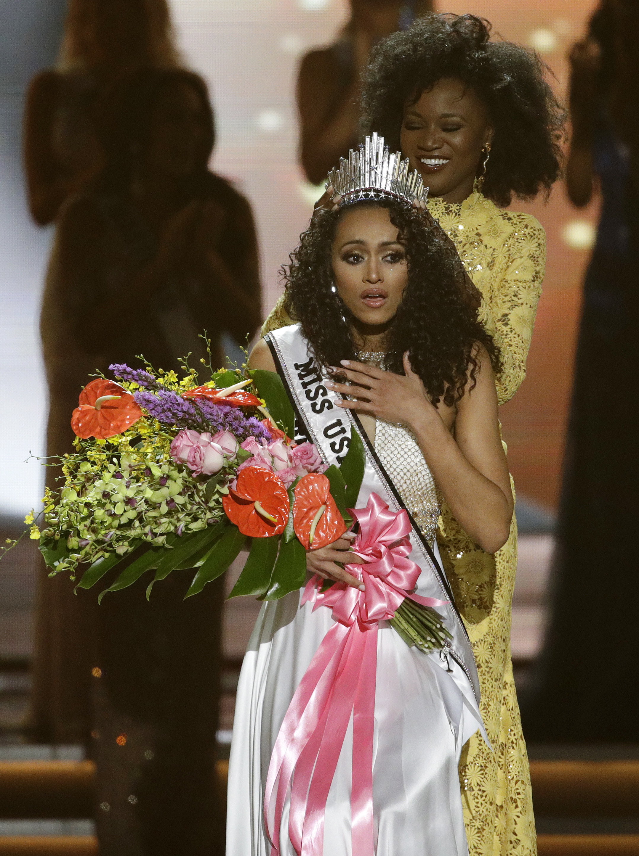 Miss USA-1 Miss District of Columbia USA Kara McCullough reacts as she is crowned the new Miss USA by former Miss USA Deshauna Barber during the Miss USA contest Sunday, May 14, 2017, in Las Vegas. (AP Photo/John Locher)