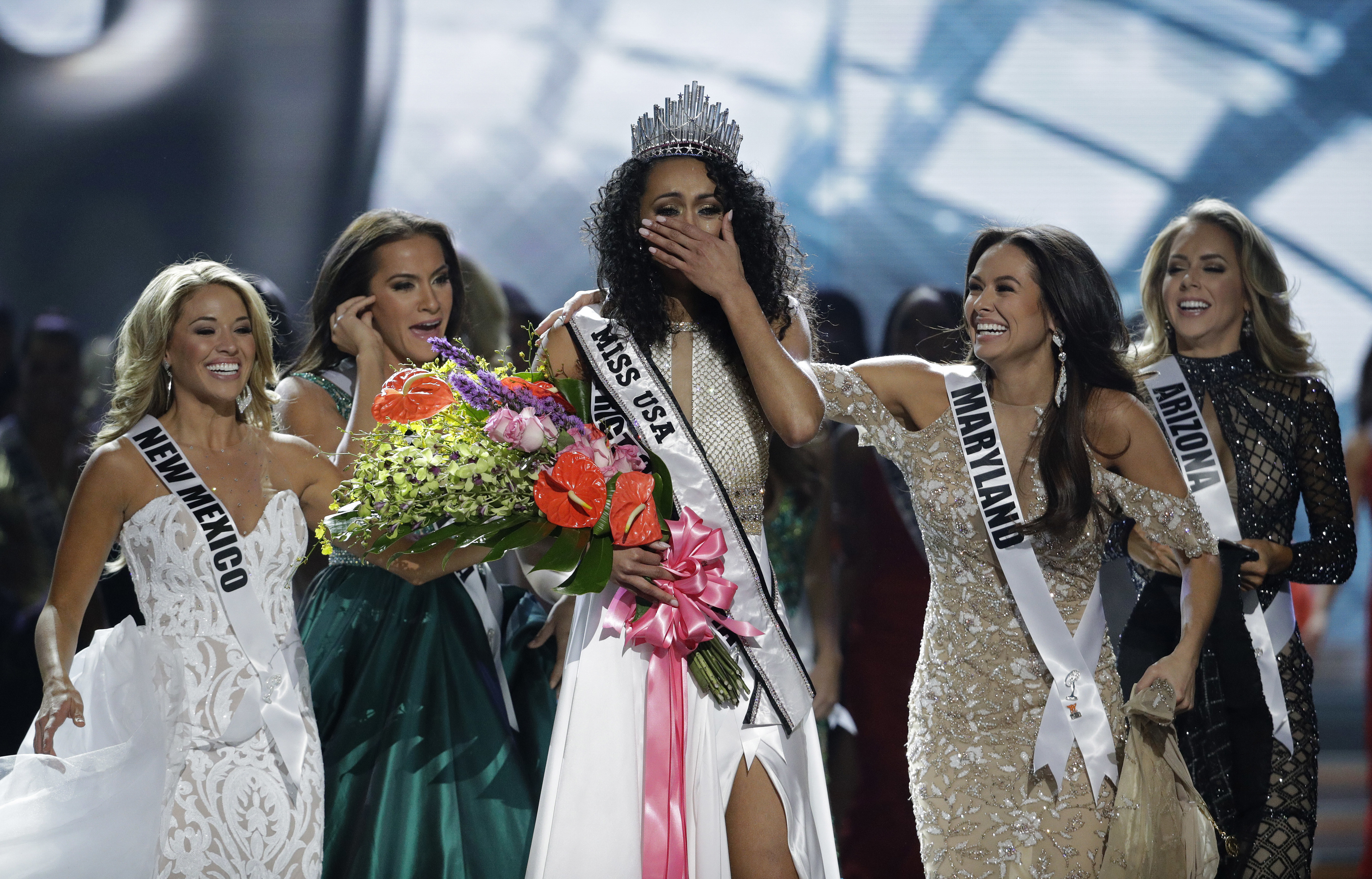 Miss USA-2 Miss District of Columbia USA Kara McCullough reacts after she was crowned the new Miss USA during the Miss USA contest Sunday, May 14, 2017, in Las Vegas. (AP Photo/John Locher)