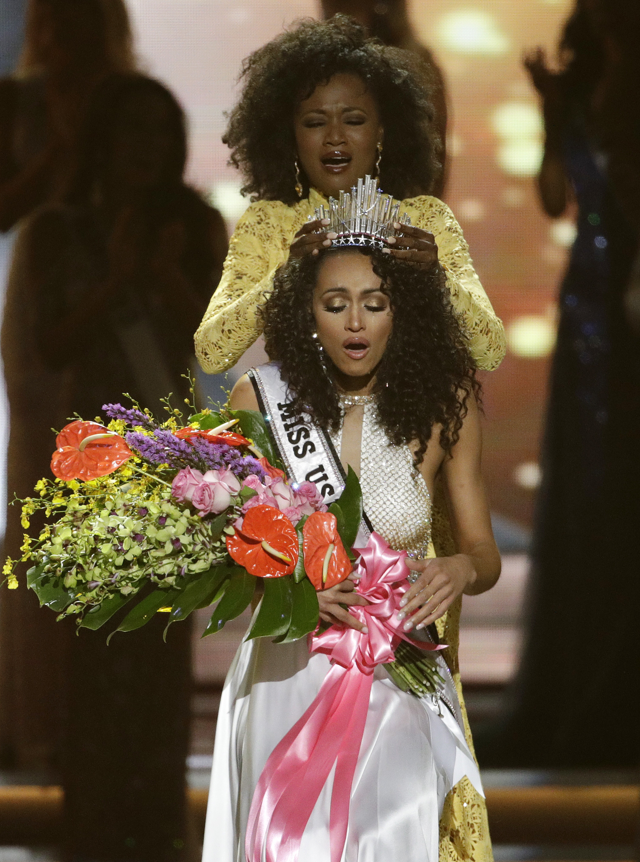 Miss USA-4 Miss District of Columbia USA Kara McCullough reacts as she is crowned the new Miss USA by former Miss USA Deshauna Barber during the Miss USA contest Sunday, May 14, 2017, in Las Vegas. (AP Photo/John Locher)
