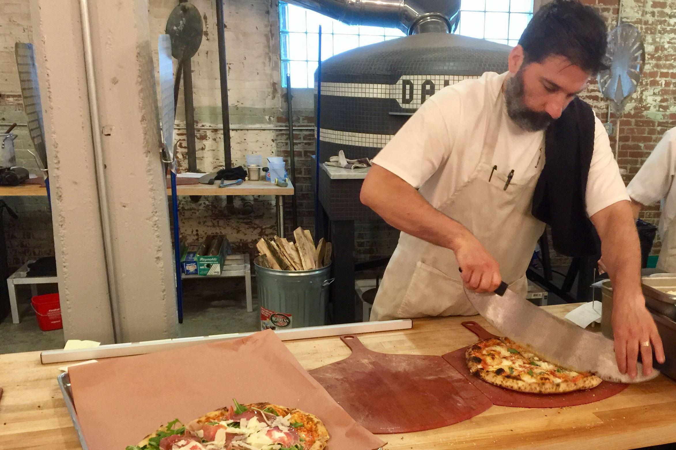 munch dal forno 07-7 Head chef Eric Delliquadri cuts a pie at Dal Forno in North Huntington.