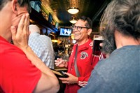 Tartan Devils midfielder Mark Fossum, 46, of Swissvale, shares a laugh with teammates at a celebratory rally for the team Monday at Piper's Pub in the South Side.