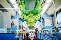 "Cirque du Soleil ""Ovo"" performer James Johnson of Missouri hangs from the handrails of a car on the T system. above performer Alanna Baker of England on their way Downtown during a promotional tour of Pittsburgh on May 16, 2017, before next week's performances at Peterson Events Center. Johnson is in costume as a cricket and Baker appears as a spider in the show."