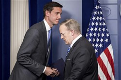 Homeland security adviser Tom Bossert takes the podium from White House press secretary Sean Spicer, right, to speak about the mass destruction offensive malware during the daily press briefing at the White House in Washington, D.C., on Monday.