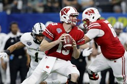 Bart Houston drops back to pass in the third quarter in January's Cotton Bowl Classic.