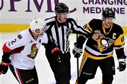 Penguins captain Sidney Crosby avoided getting laid out by Ottawa's Dion Phaneuf, but two of his teammates weren't as lucky.