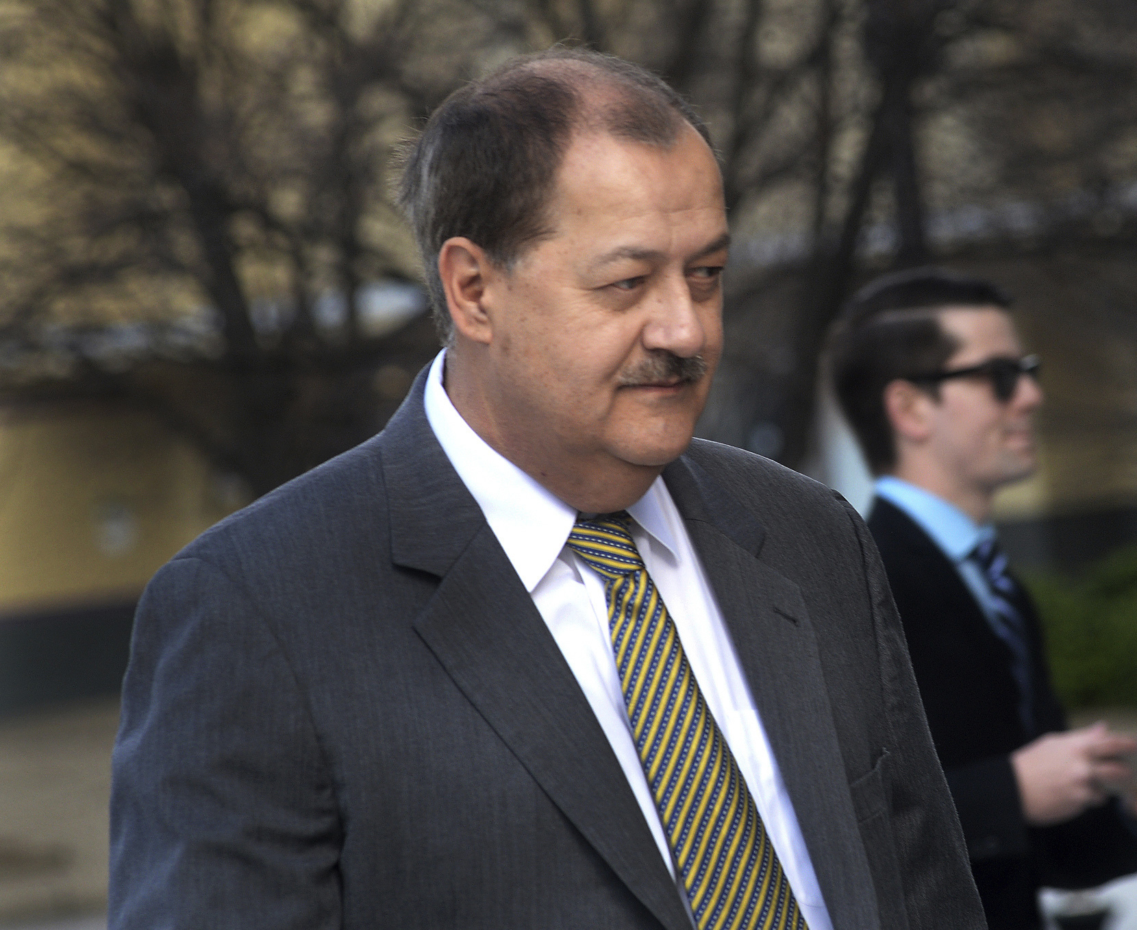 Mine Explosion-Blankenship FILE - In a Wednesday, April 6, 2016, file photo, former Massey CEO Don Blankenship is escorted by Homeland Security officers from the Robert C. Byrd U.S. Courthouse in Charleston, W. Va. Blankenship has asked President Donald Trump to resist attempts in Congress to enhance criminal penalties for coal executives who violate mine safety and health standards. Blankenship, who recently was freed from federal prison, also asked the president in a letter Tuesday, May 16, 2017, to re-examine a federal investigation into the nation's worst coal mining disaster in four decades. (F. Brian Ferguson/Charleston Gazette-Mail via AP, File)