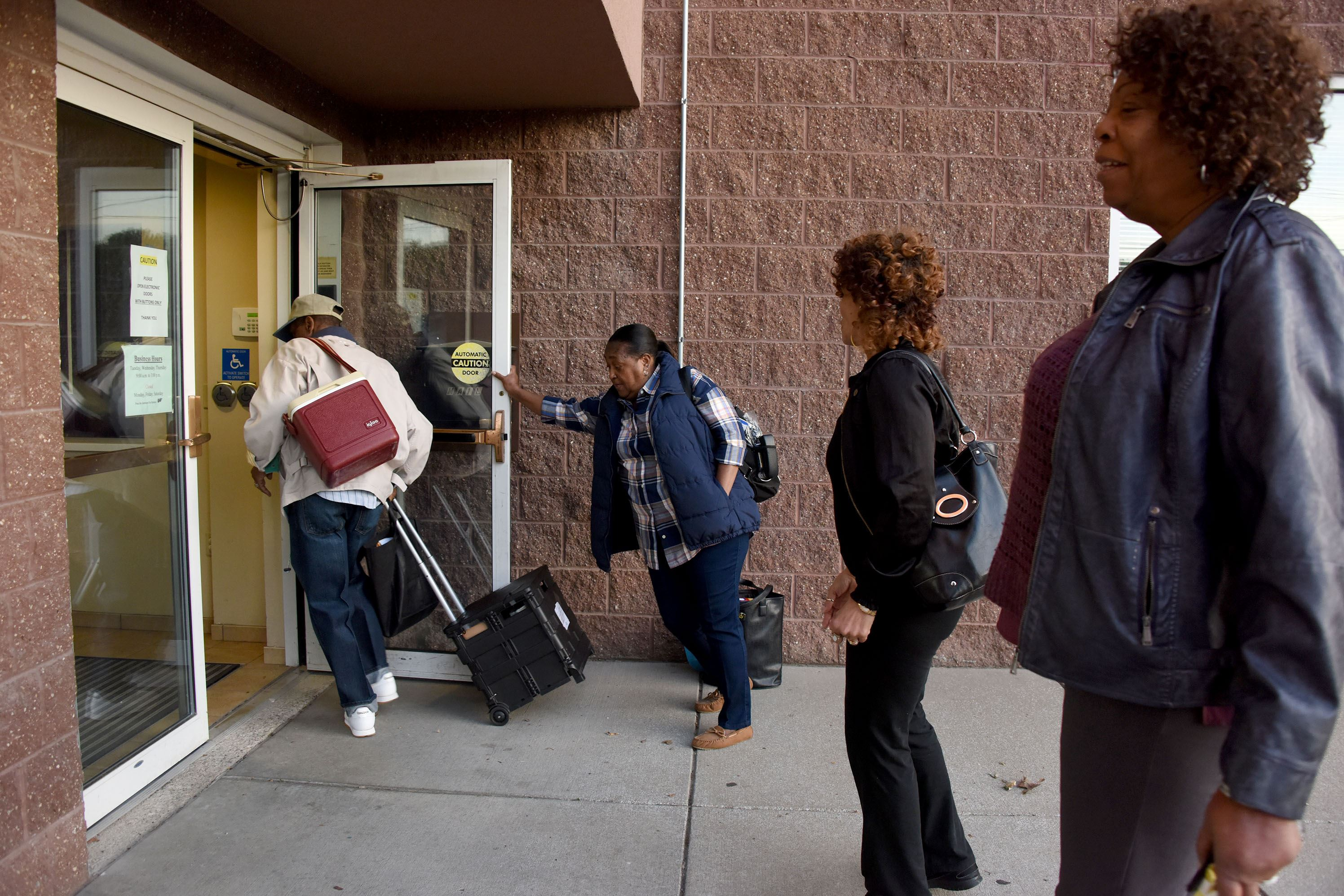 election Day Poll workers open the doors to set up for primary election day voting at the Ebenezer Baptist Church on Wylie Avenue in the Hill District Tuesday morning.