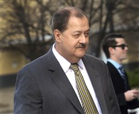In a Wednesday, April 6, 2016, file photo, former Massey CEO Don Blankenship is escorted by Homeland Security officers from the Robert C. Byrd U.S. Courthouse in Charleston, W. Va. Blankenship has asked President Donald Trump to resist attempts in Congress to enhance criminal penalties for coal executives who violate mine safety and health standards. Blankenship, who recently was freed from federal prison, also asked the president in a letter Tuesday, May 16, 2017, to re-examine a federal investigation into the nation's worst coal mining disaster in four decades.