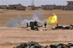 Syrian government forces fire artillery during a battle against the Islamic State group Tuesday in the town of Maskana, on the edge of Lake Assad in the eastern part of the Aleppo province.