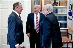 U.S. President Donald Trump meets with Russian Foreign Minister Sergey Lavrov, left, next to Russian Ambassador to the U.S. Sergei Kislyak at the White House in Washington, Wednesday, May 10, 2017.