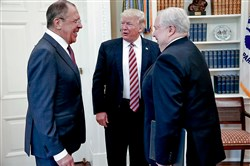 U.S. President Donald Trump meets with Russian Foreign Minister Sergey Lavrov, left, next to Russian Ambassador to the U.S. Sergey Kislyak at the White House May 10.