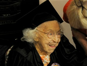 Theresia Brandl, 105, a resident of Victoria Manor in Oakdale, is all smiles after receiving her Sto-Rox High School diploma on Wednesday, May 15, 2017.