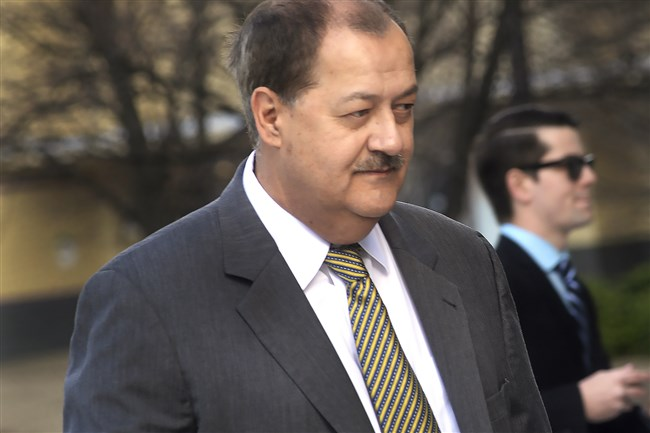 Former Massey CEO Don Blankenship is escorted by Homeland Security officers from the Robert C. Byrd U.S. Courthouse in Charleston, W. Va. in 2016. Blankenship has petitioned the U.S. Supreme Court to overturn his conviction for misdemeanor conspiracy to violate federal safety standards at a West Virginia mine where 29 miners died in 2010.