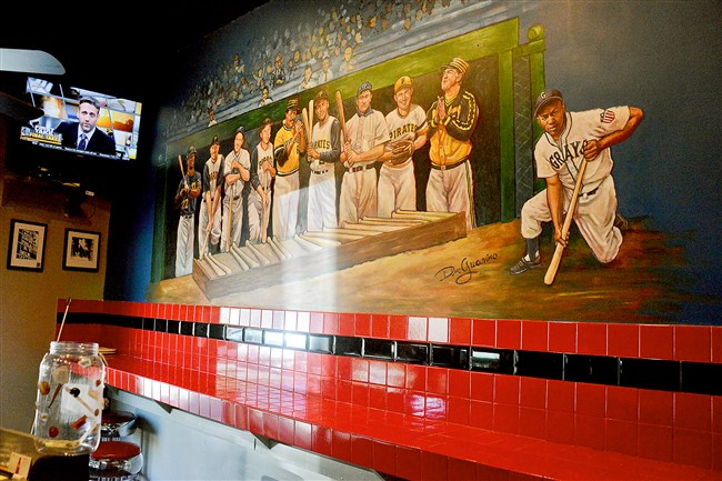 The interior of Dugout Deli in Mount Washington features a mural of Pittsburgh baseball hall of fame players.