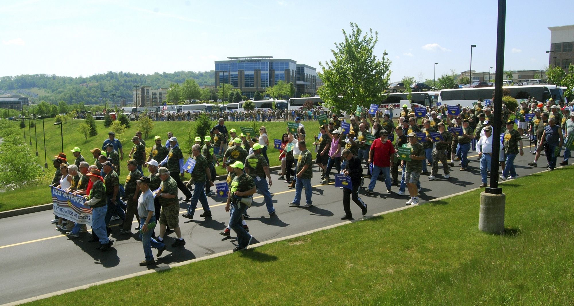Consol Energy-Protest-4 With their president, Cecil Roberts, leading the way, an estimated fifteen hundred UMWA members who attended a Wednesday, May 17, 2017, protest rally march in front of Consol headquarters in Southpointe, Pa., and onto Consol property. Roberts and Richard Fink, a retired miner and former Armstrong County commissioner, were subsequently arrested by Cecil Township police for trespassing. The union said Wednesday morning's rally was to protest what it called attempts by the company to reduce health benefits for retirees and to protect pensions of retired coal miners. (Mark Marietta /Observer-Reporter via AP)