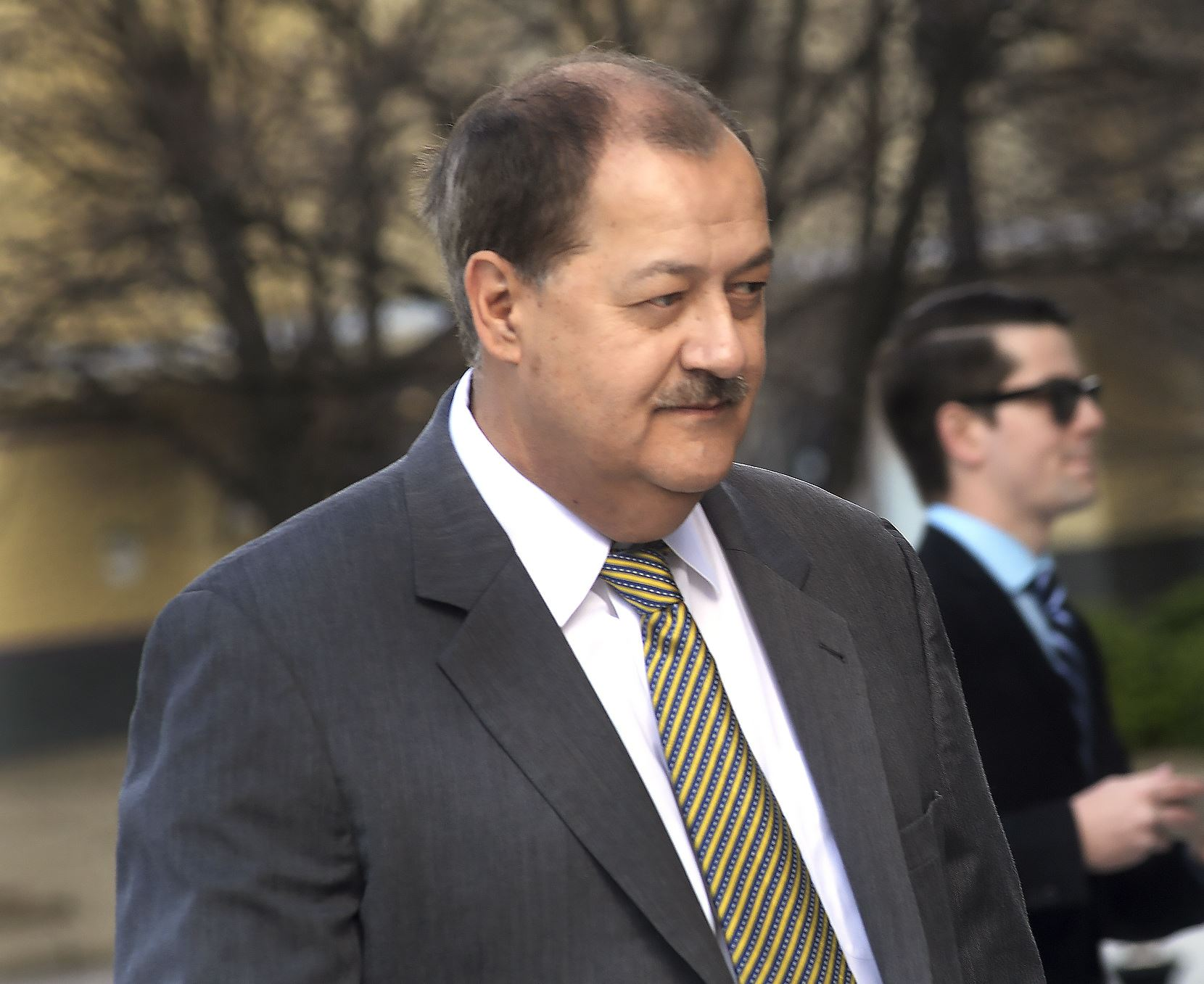 Mine Explosion-Blankenship In a Wednesday, April 6, 2016, file photo, former Massey CEO Don Blankenship is escorted by Homeland Security officers from the Robert C. Byrd U.S. Courthouse in Charleston, W. Va. Blankenship has asked President Donald Trump to resist attempts in Congress to enhance criminal penalties for coal executives who violate mine safety and health standards. Blankenship, who recently was freed from federal prison, also asked the president in a letter Tuesday, May 16, 2017, to re-examine a federal investigation into the nation's worst coal mining disaster in four decades.