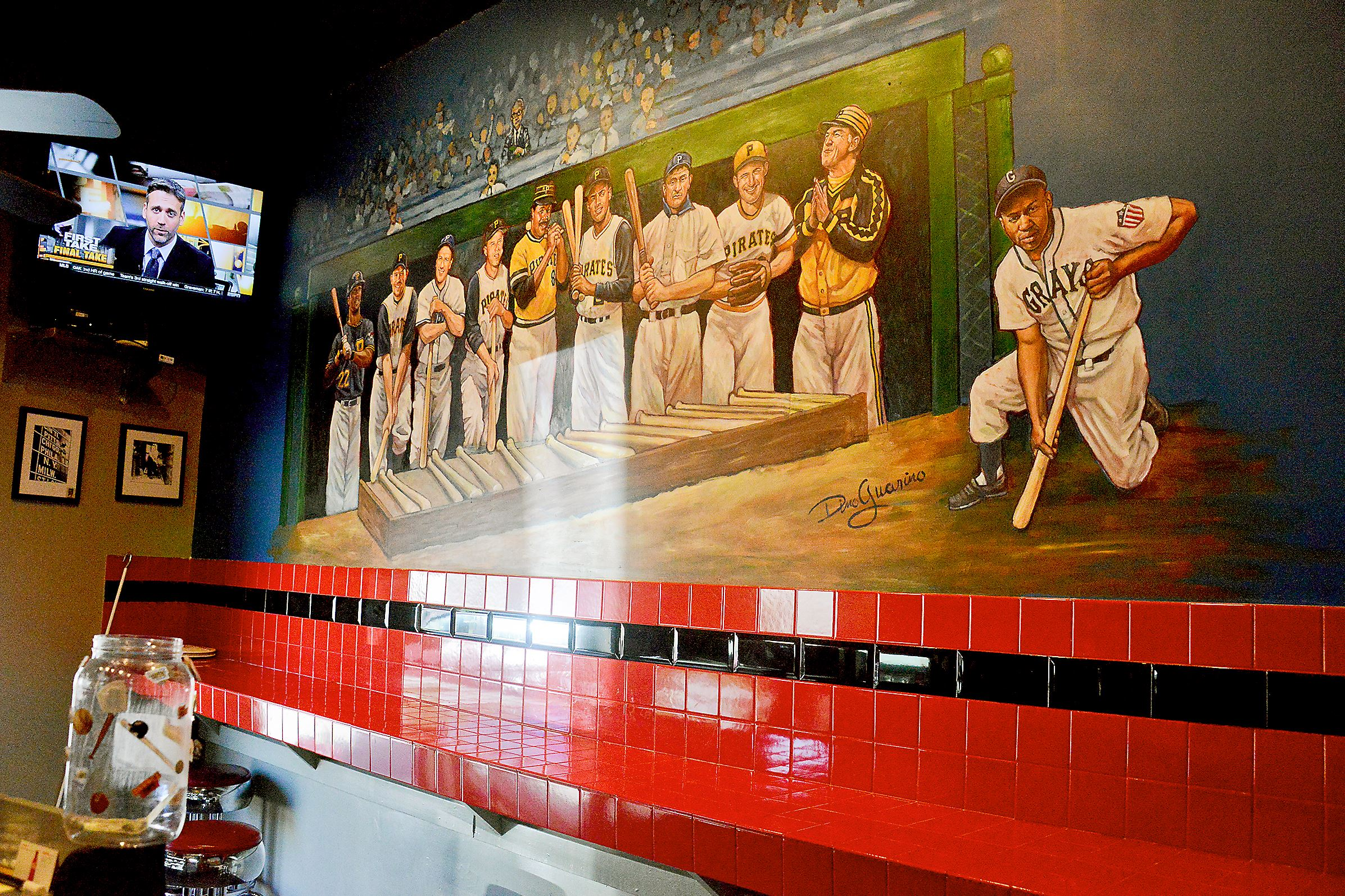 20170509lf-Deli01 The interior of Dugout Deli in Mount Washington features a mural of Pittsburgh baseball hall of fame players.