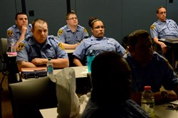 Justin Miller, left, Chelle Salisbury and other new EMTs listen during a training session at Pittsburgh's Bureau of Emergency Services in the Strip District on May 18. The 14 EMTs hired by the city this year have already had an impact.