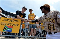Pirates Gift Ngoepe greets Dan Jones, a missionary doctor from Zambia, before taking on the Nationals May 18 at PNC Park.