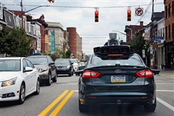 The National Summit on Design & Urban Mobility released its final report on Wednesday. It said cities should begin planning now so they aren't surprised when changes begin -- like regulations that govern autonomous vehicles, such as this Uber vehicle in Pittsburgh