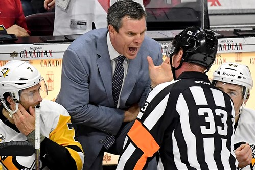 Penguins head coach Mike Sullivan gives referee Kevin Pollock an earful after a no call in a recent playoff game against the Ottawa Senators.