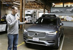 Anthony Levandowski, who has been the focus of a lawsuit between Waymo and Uber, is seen here in December speaking about Uber's self-driving car in San Francisco.