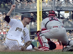 Jordy Mercer scores on Phillies catcher Cameron Rupp in the sixth inning May 20.
