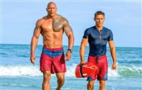 "Dwayne Johnson as Mitch Buchannon and Zac Efron as Matt Brody in ""Baywatch."""