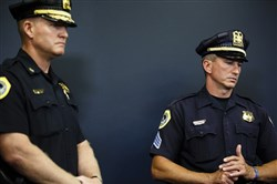 Des Moines police Chief Dana Wingert , left, and Sgt. Paul Parizek, right, during a press conference at the Polk County Justice Center after Scott Michael Greene switched his plea to guilty Friday.
