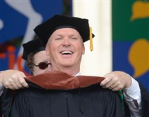 Michael Keaton reacts as he receives his doctoral hood at the Carnegie Mellon University's commencement ceremony on Sunday.